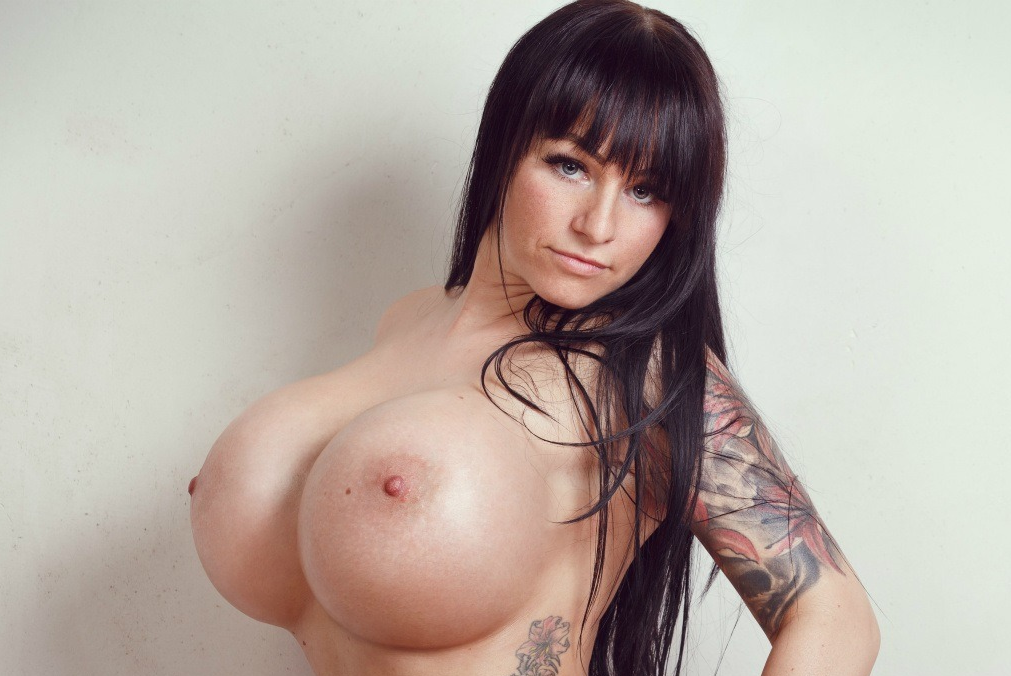 Brunette with fake huge tits